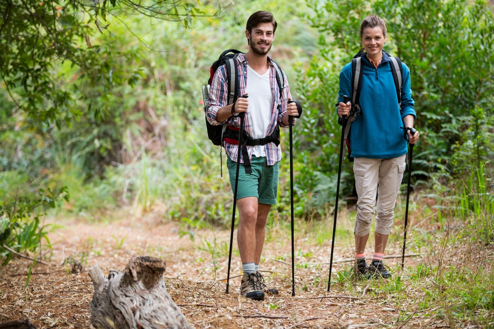Couple hiking through a forest in the countryside-1